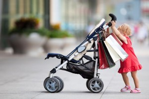 Young girl with carriage. shopping series